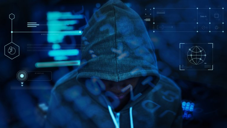 Man looking down wearing a jacket with the hood covering his head blended into a blue background that displays various charts of information