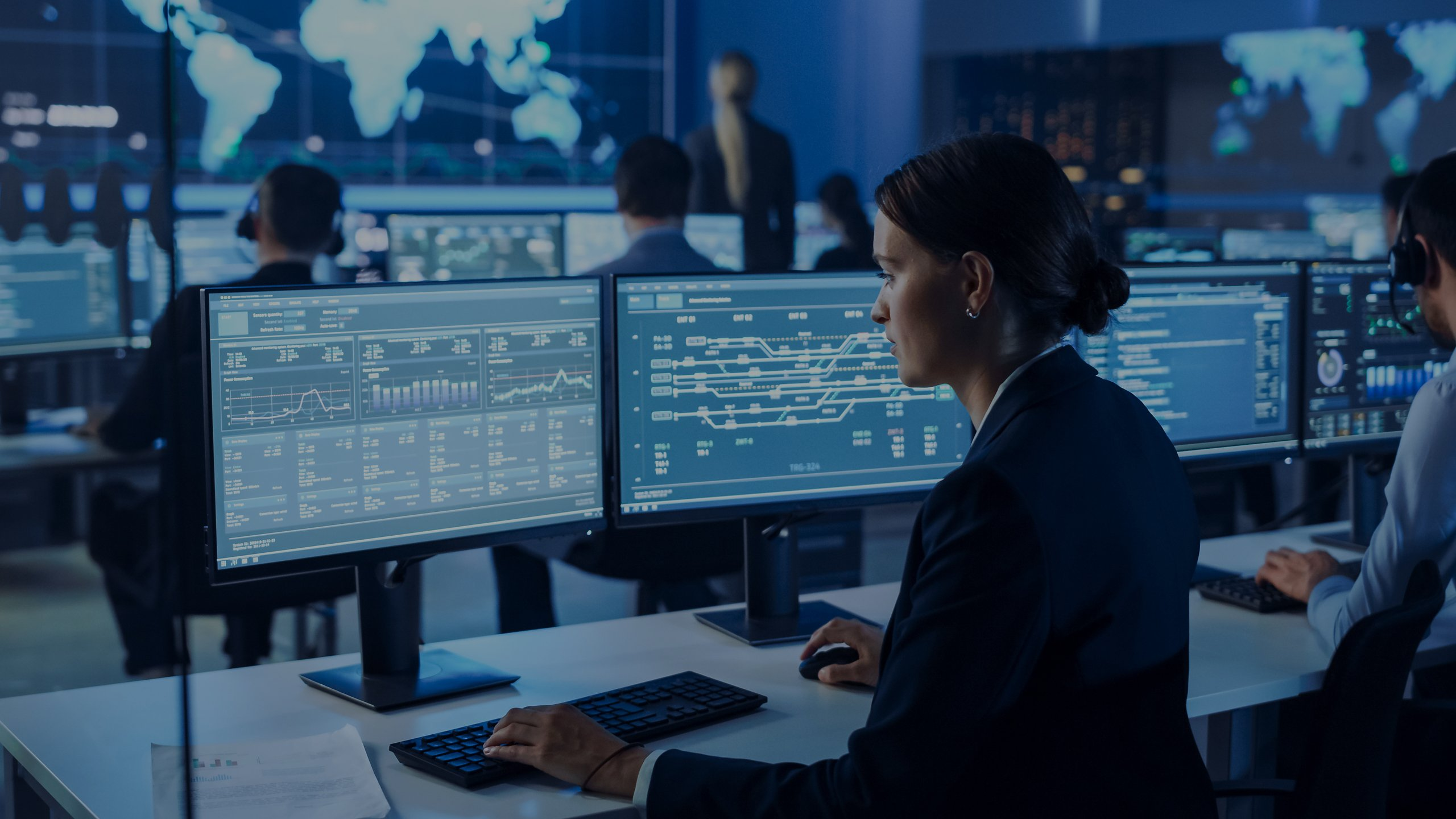 Data scientist working at computer in control room