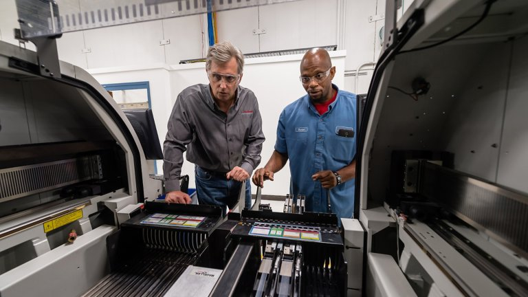 Two Rockwell Automation employees in the Twinsburg Ohio facility viewing a machine in operation
