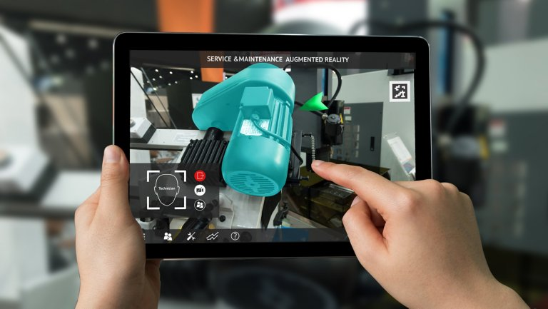 Service maintenance on a part with augmented reality on a tablet.