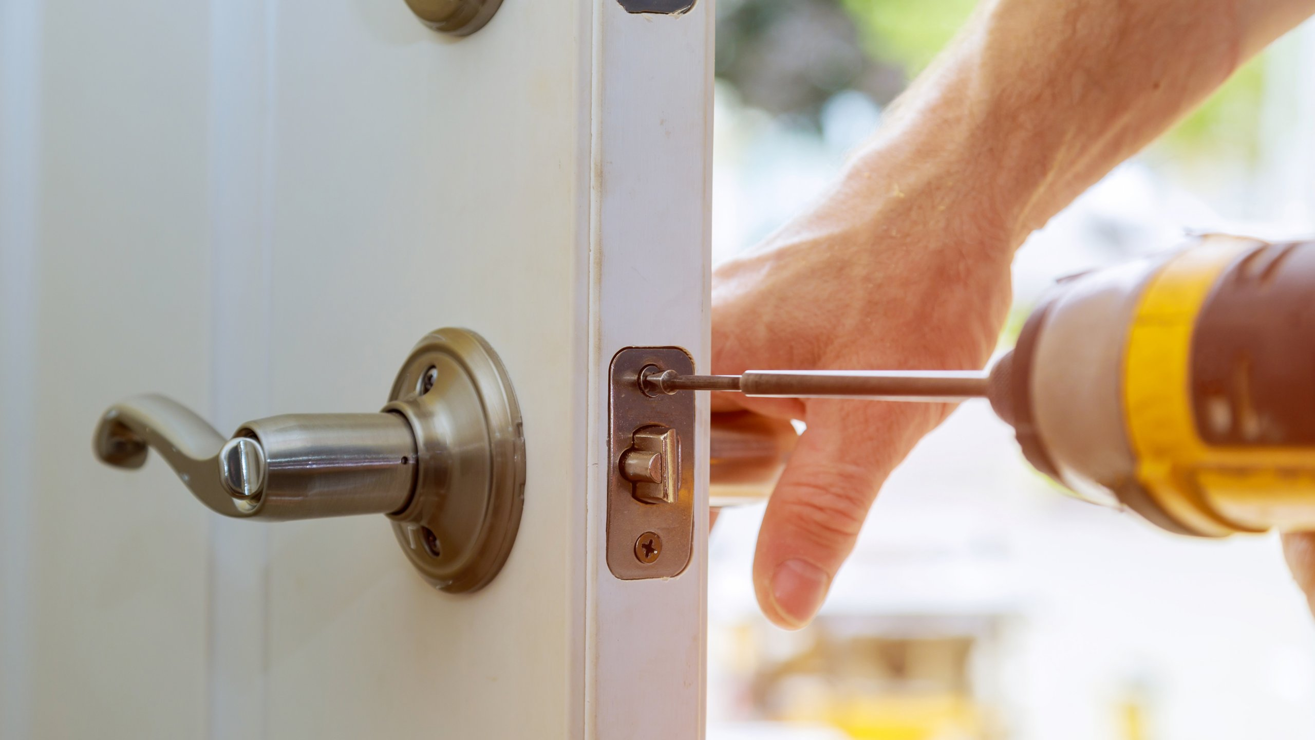 Drilling in screws for door handle assembly