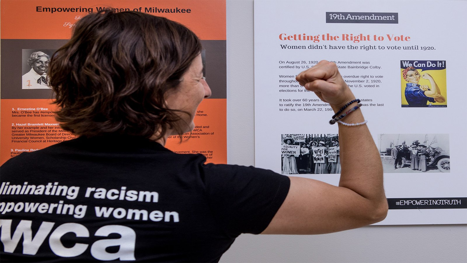 We Can Do It YWCA Woman Making Muscle