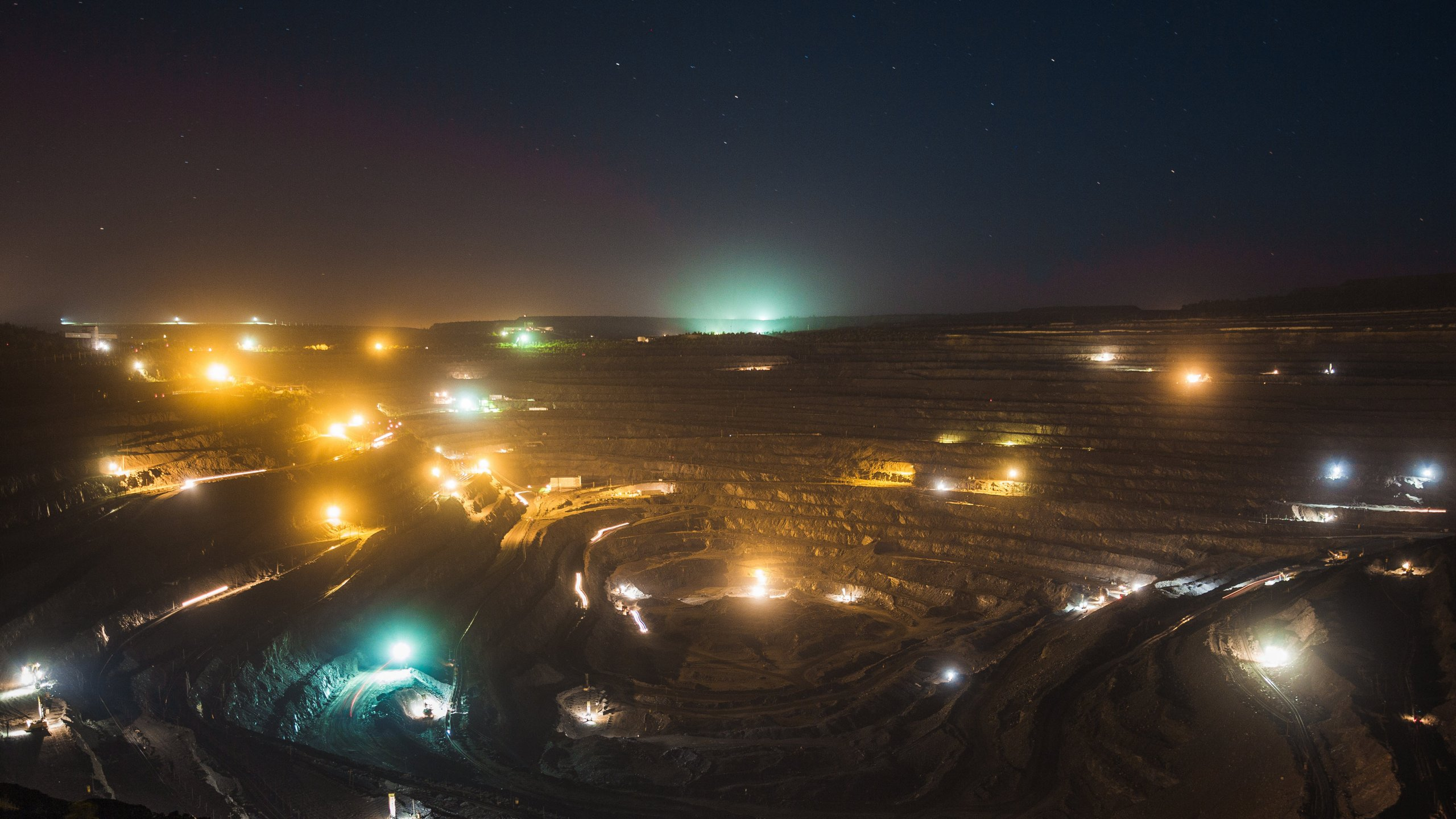 Open pit mining operations in the evening