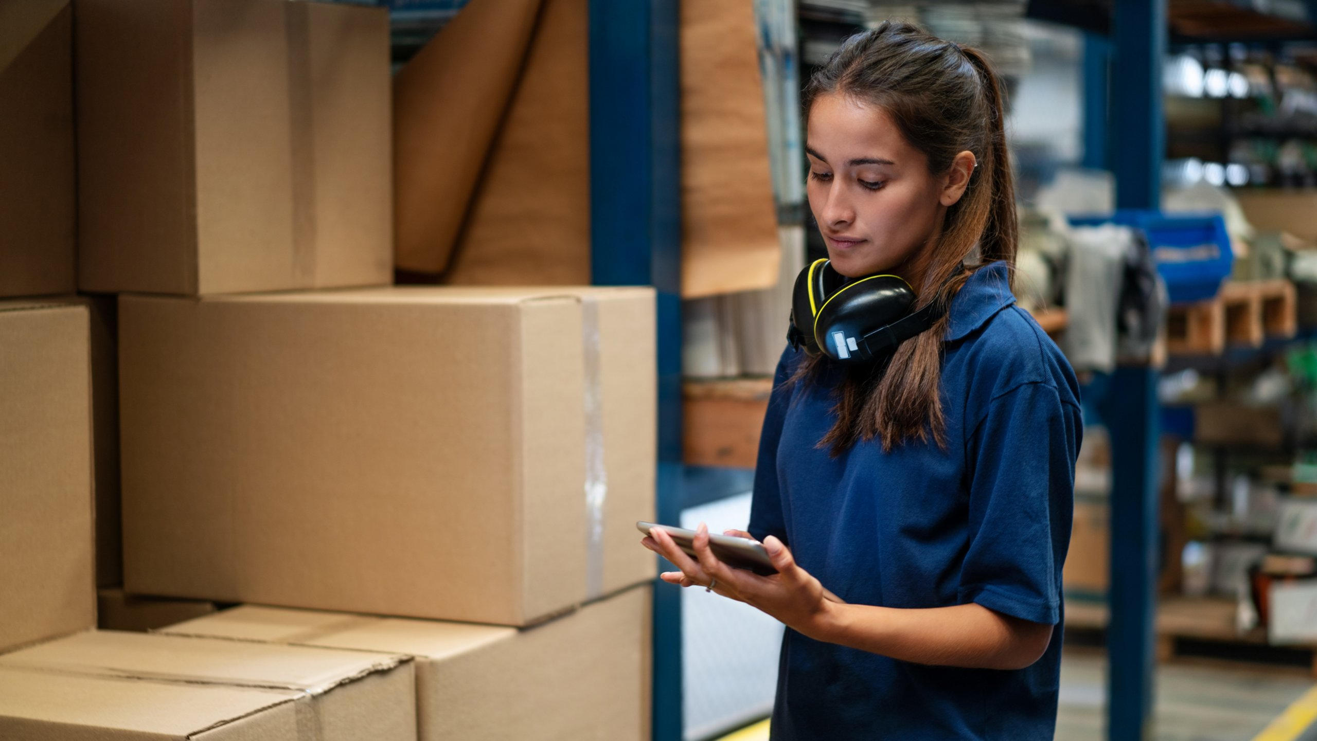 Employee tracking packages on her tablet