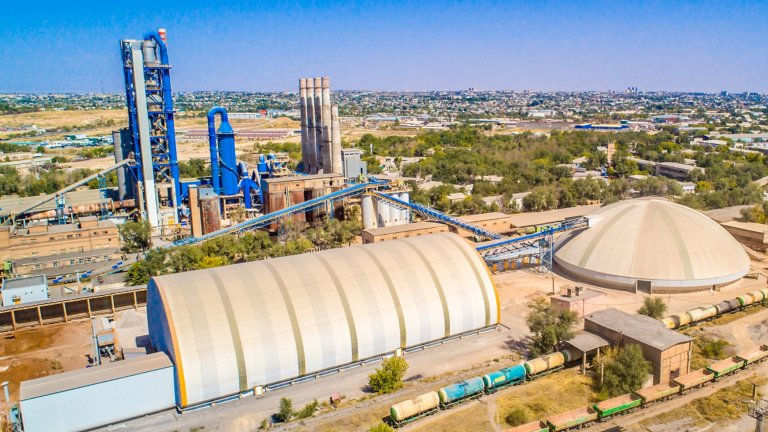 Arial image of a cement plant in the day time with blues skies n the desert