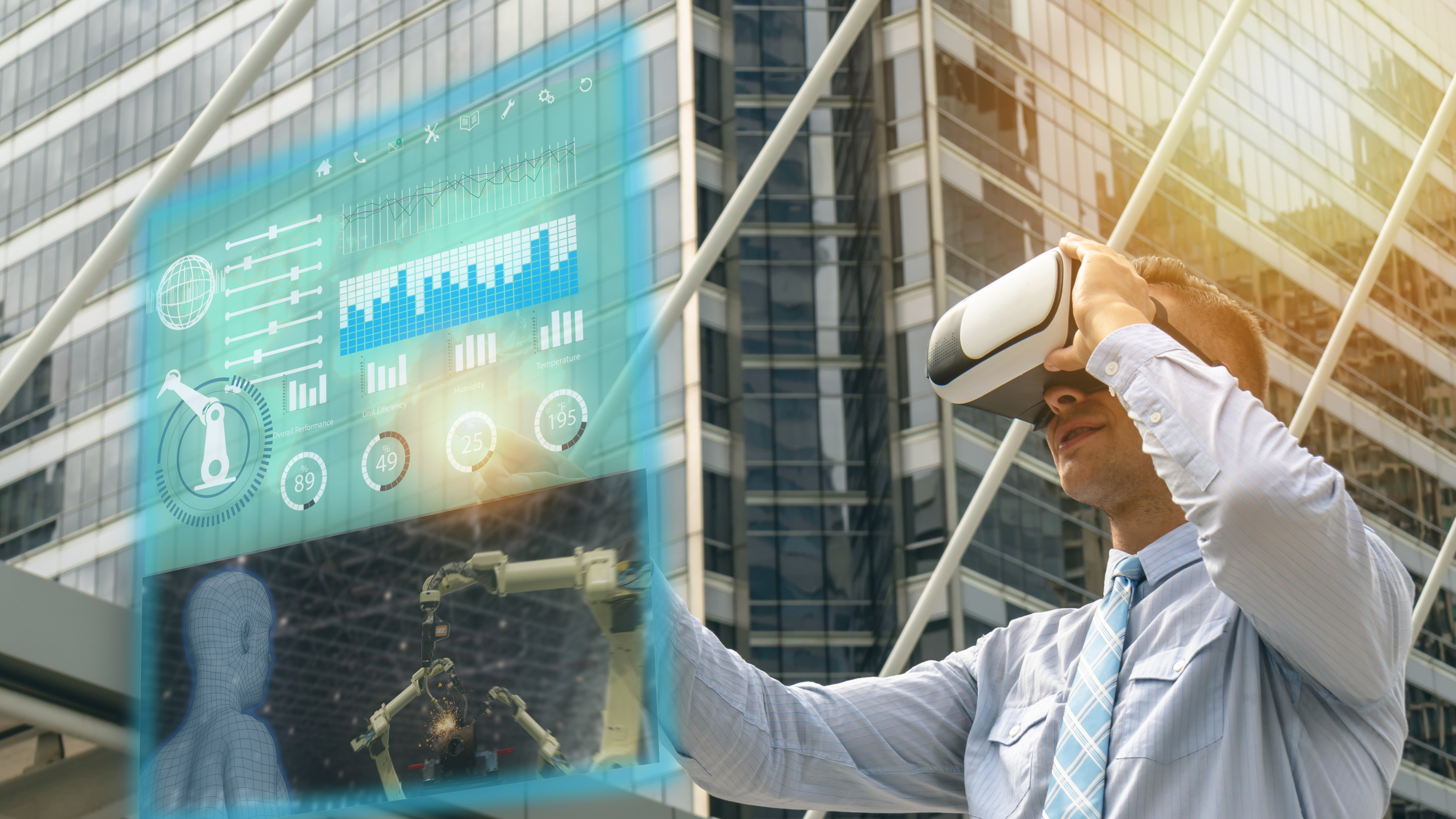 Man wearing VR head gear interacting with a virtual screen and standing in front of a tall building with many windows