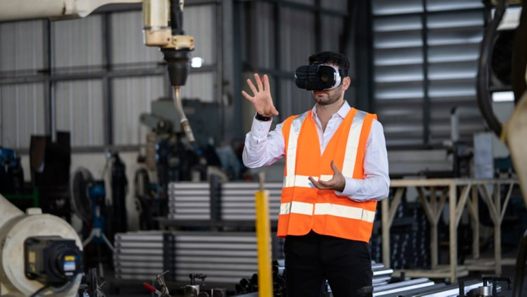 Engineer wearing a VR headset in a plant