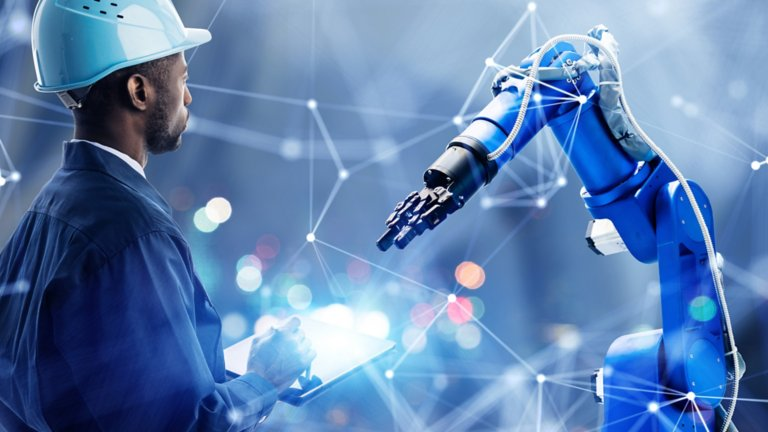 conceptual image of man in hard hat and robotic arm