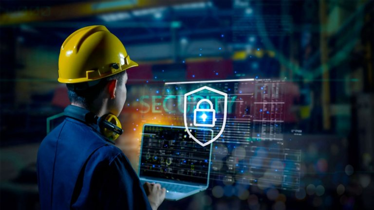 Employee checking cybersecurity OT systems to prevent and detect possible risks