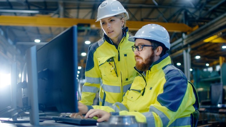 Workers remotely accessing their cybersecurity asset management system to protect their plants.