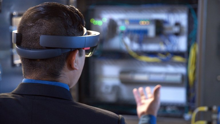 Worker using extended reality uses a mix of wearable and handheld augmented reality (AR), mixed reality (MR) and virtual reality (VR) tools