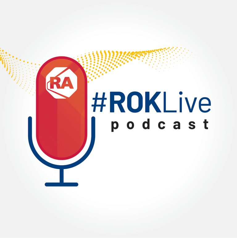 ROKLive podcast red microphone on blue stand with RA logo at the top and yellow transparent swirl in background
