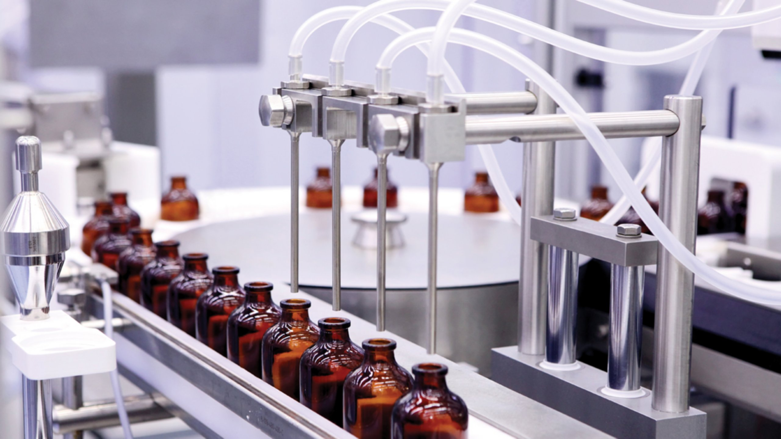 Bottling equipment at a food and beverage processing plant.