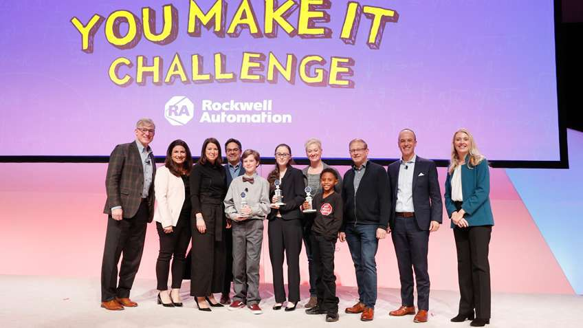 The three finalists of the You Make it Challenge contest pose with their mentors and the judges.