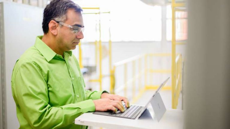 Rockwell Automation employee typing information into his laptop