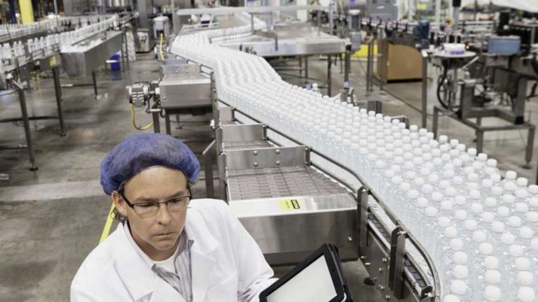 Employee wearing a hairnet in beverage processing plant